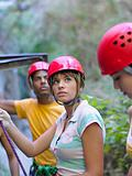 Teenagers wearing abseiling equipment