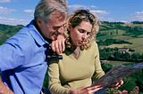 Couple in field looking at map