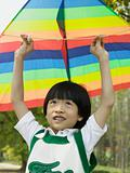 Boy holding kite