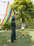 Father and son playing with a kite
