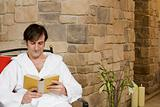 Man relaxing with a book