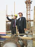 Businessmen on a building site