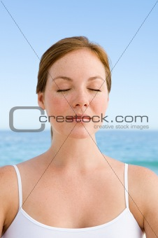 Young woman with eyes closed
