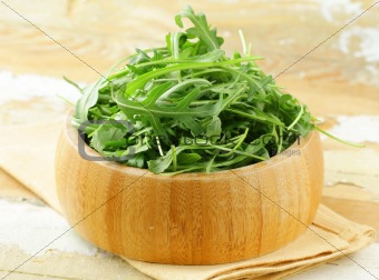 bowl of fresh green, natural arugula