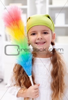 Little girl with dusting brush