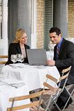 Businesspeople in restaurant with laptop