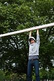 Young man hanging from a goalpost