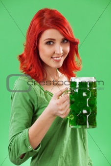 Redhead drinking green beer