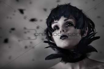 Crow girl with feather wig and black eyes