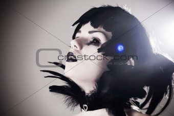 Crow girl with creepy black eyes and feather hair