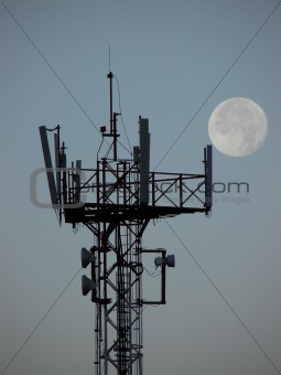 Cell tower at dawn with the moon
