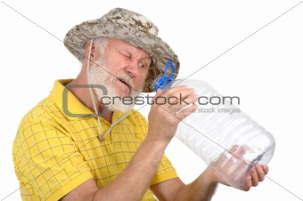 senior man looking into empty bottle