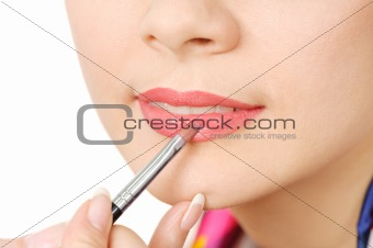 applying liquid glossy lipstick