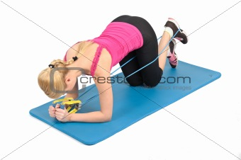 Young blond girl doing kneeling butt blaster exercise using rubber resistance band. position 1 of 2.