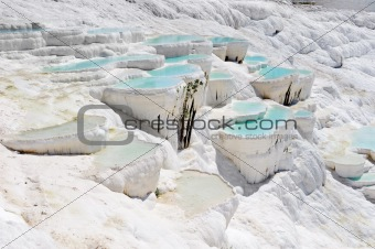 Blue water travertine pools at Pamukkale, Turkey
