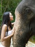 Young woman stroking an elephant