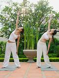 Two women practising yoga