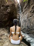 Rear view of young woman meditating