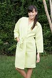 Woman in garden in bathrobe
