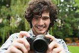 Young man using camera
