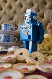 Robot toy with cakes and biscuits