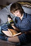 Boy with book and torch