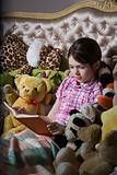 Girl with book and toys