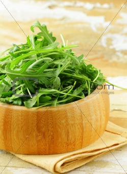 bowl of fresh green, natural arugula