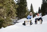 Friends riding a toboggan