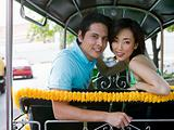 Couple riding in a tuk-tuk