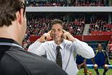 Football manager and referee arguing