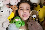 Girl with soft toys