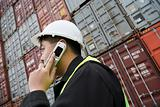 Man on cellphone at container terminal
