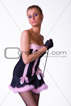 Female model posing in blak and pink dress