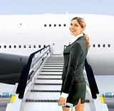flight attendant near moving ramp