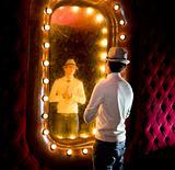 retro man looks on mirror