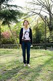 Woman in park with badminton racket