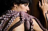 Young woman with a dead octopus on her shoulder
