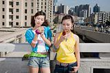 Teenage girls with cellphones