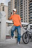 Young man with bike and cellphone