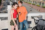 Teenage boy and girl looking at cellphone