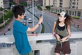 Teenage couple with camera phone