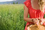 Woman in a field with grain