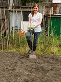 A gardener digging on their allotment