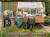 Wheelbarrows and a green house on an allotment