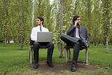 Businessmen working in a park
