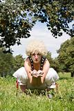 Female clown in a field