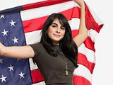 Teenage girl holding a flag