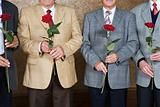 Senior men holding roses
