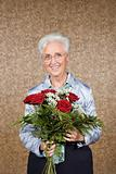 Senior woman with bouquet of flowers
